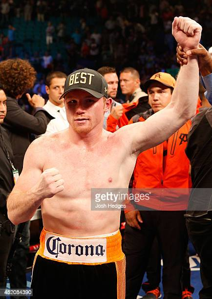 Canelo Alvarez poses after his splitdecision victory over Erislandy Lara during their junior middleweight bout at the MGM Grand Garden Arena on July...