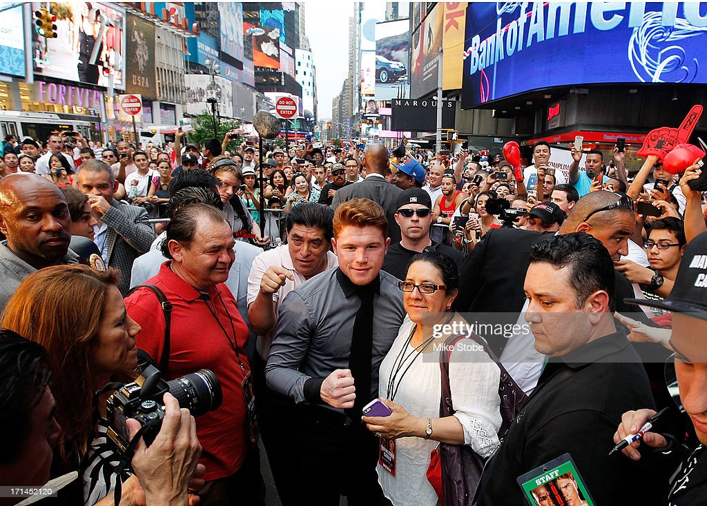 Canelo Alvarez poses for a photo with a fan following a news conference at the Pedestrian Walk in Times Square on June 24, 2013 in New York City. Floyd Mayweather and Canelo Alvarez are scheduled to fight September 14 at the MGM Grand in Las Vegas, Nevada to unifty their junior middleweight world titles.