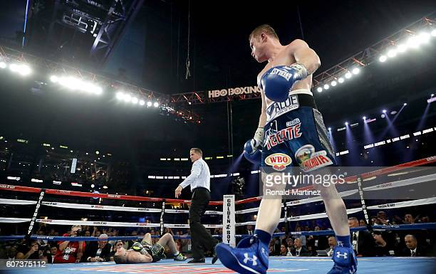 Canelo Alvarez right looks toward Liam Smith left after knocking him down during the WBO Junior Middleweight World fight at ATT Stadium on September...