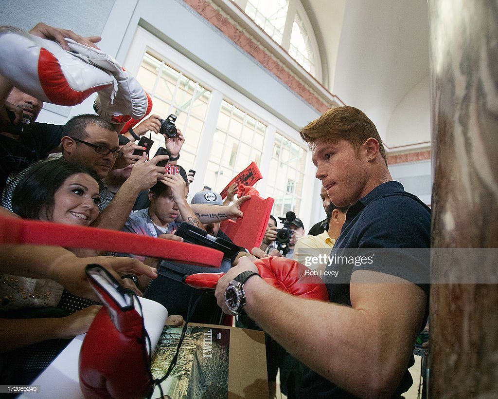 Canelo Alvarez signs autographs after a press conference July 1, 2013 at Union Station at Minute Maid Park in Houston, Texas. Floyd Mayweather and Canelo Alvarez are scheduled to fight September 14 at the MGM Grand Garden Arena in Las Vegas, Nevada.