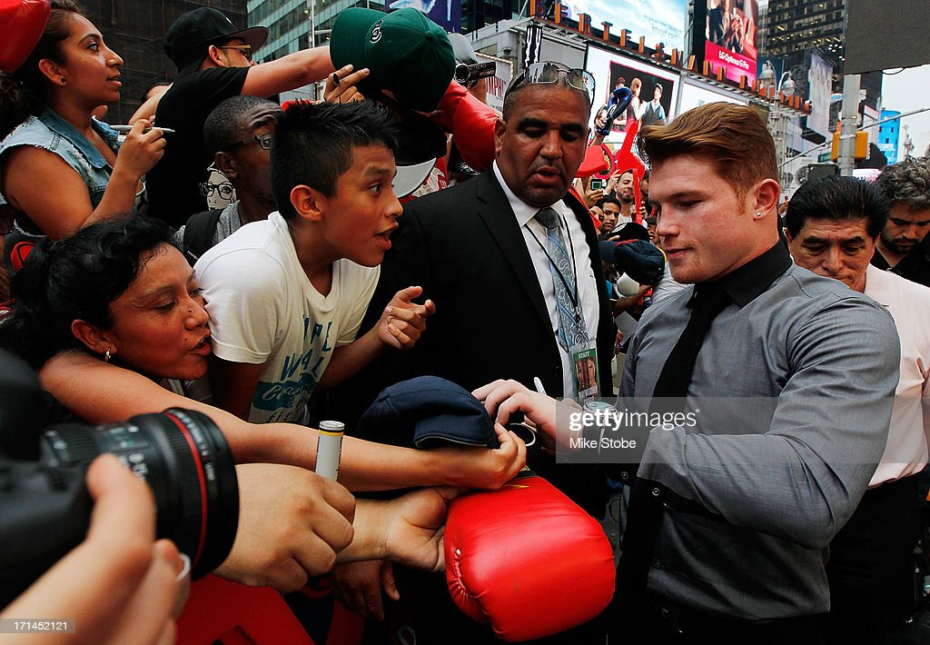 Canelo Alvarez signs autographs following a news conference at the Pedestrian Walk in Times Square on June 24, 2013 in New York City. Floyd Mayweather and Canelo Alvarez are scheduled to fight September 14 at the MGM Grand in Las Vegas, Nevada to unifty their junior middleweight world titles.
