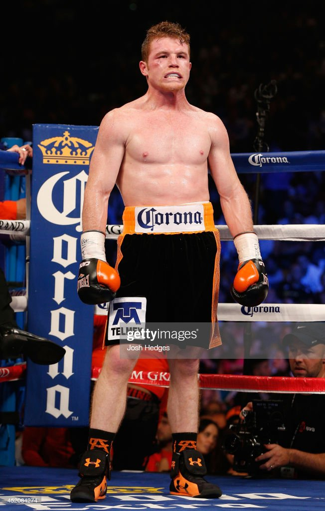Canelo Alvarez stands in the ring between rounds during his junior middleweight bout against Erislandy Lara at the MGM Grand Garden Arena on July 12, 2014 in Las Vegas, Nevada. Alvarez defeated Lara by split decision.