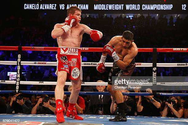 Canelo Alvarez throws a left at Amir Khan during the WBC middleweight title fight at TMobile Arena on May 7 2016 in Las Vegas Nevada