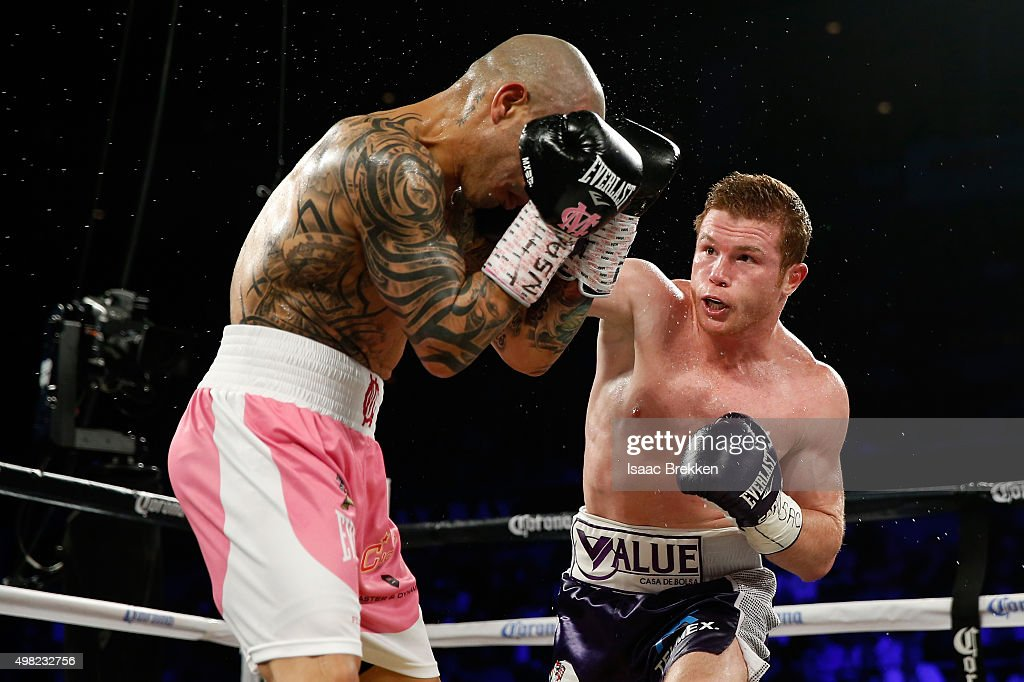 Canelo Alvarez throws a right at Miguel Cotto during their middleweight fight at the Mandalay Bay Events Center on November 21, 2015 in Las Vegas, Nevada.