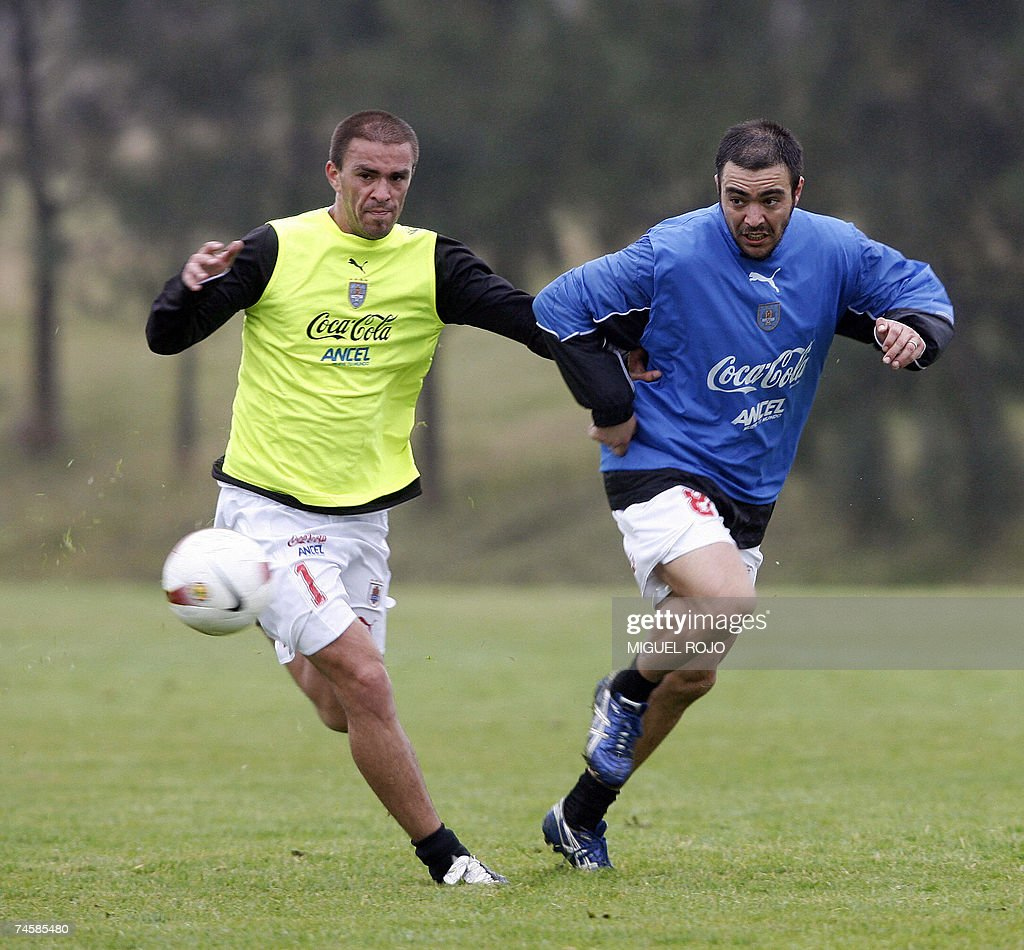 Alvaro Recoba and Andres Scotti vie for the ball during a training session of the Uruguayan national football team in Canelones close to Montevideo...