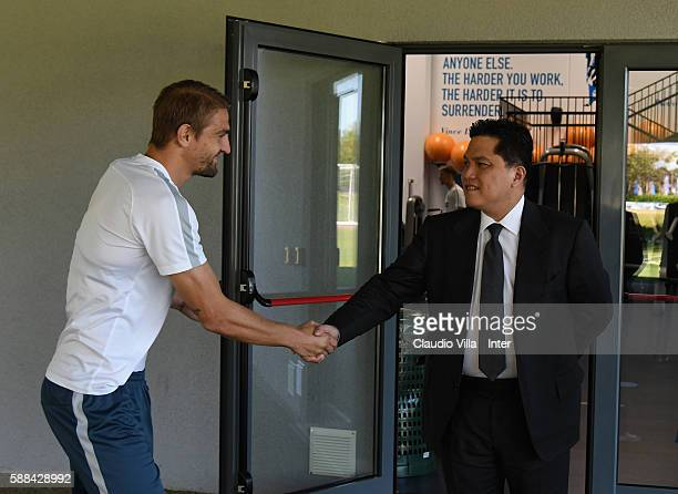 Caner Erkin and President Erick Thohir chat prior to the FC Internazionale training session at the club's training ground at Appiano Gentile on...