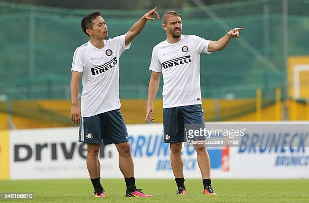 Caner Erkin and Yuto Nagatomo gesture during day Six of the FC Internazionale training camp on July 11 2016 in Bruneck Italy