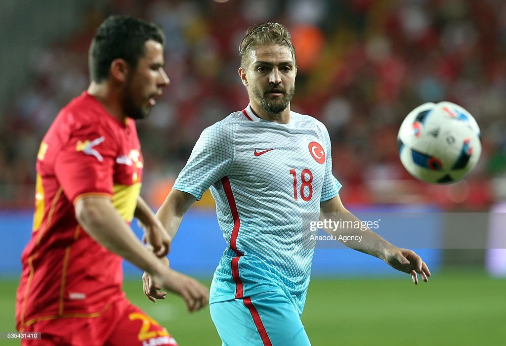 Caner Erkin (R) of Turkey and and Jovovic (L) of Montenegro vie for the ball during the friendly football match between Turkey and Montenegro at Antalya Ataturk Stadium in Antalya, Turkey on May 29, 2016.