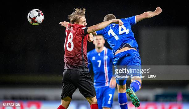 Caner Erkin of Turkey challenges Kari Arnason of Iceland during the FIFA 2018 World Cup Qualifier between Iceland and Turkey at Laugardalsvoellur on...