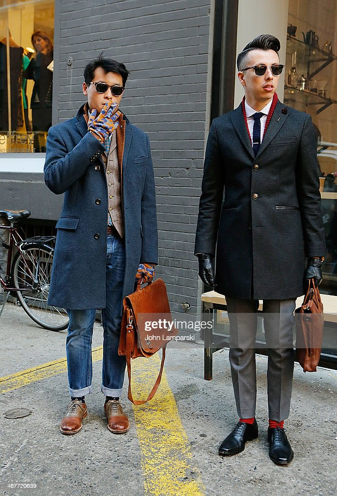 Cang Nguyes is seen wearing a coat from J Crew and the rest from Anos and Blake Scott is wearing everything from Zara during New York Fashion Week Fall 2014 at Streets of Manhattan on February 7, 2014 in New York City.