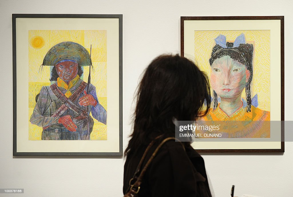 'Cangaceiro' (L) and 'Menina com Trancas e Lacos' by Candido Portinari are on display during a preview of Christie's Latin American Art auctions, May 24, 2010 in New York. Christie's will hold its Latin American Art auctions on May 26 and 27, 2010. AFP PHOTO/Emmanuel Dunand
