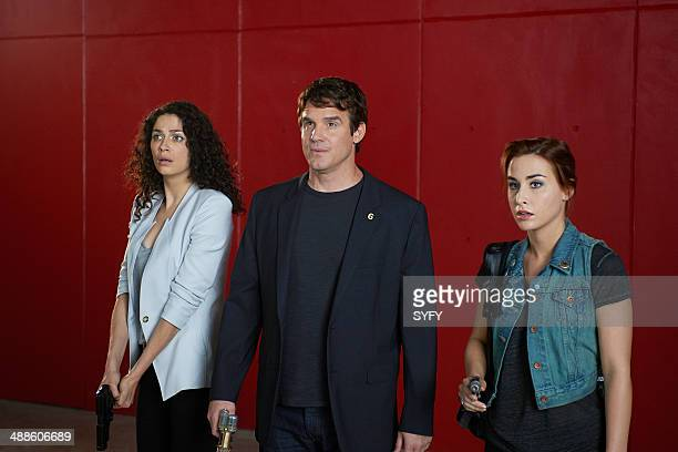 WAREHOUSE 13 'Cangku Shisi' Episode 505 Pictured Joanne Kelly as Myka Bering Eddie McClintock as Pete Lattimer Allison Scagliotti as Claudia Donovan