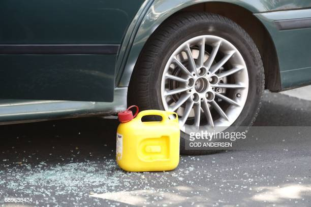 A canister stands next to a suspicious car in Berlin's Schoeneberg district where a man was arrested after the car was discovered shortly before an...