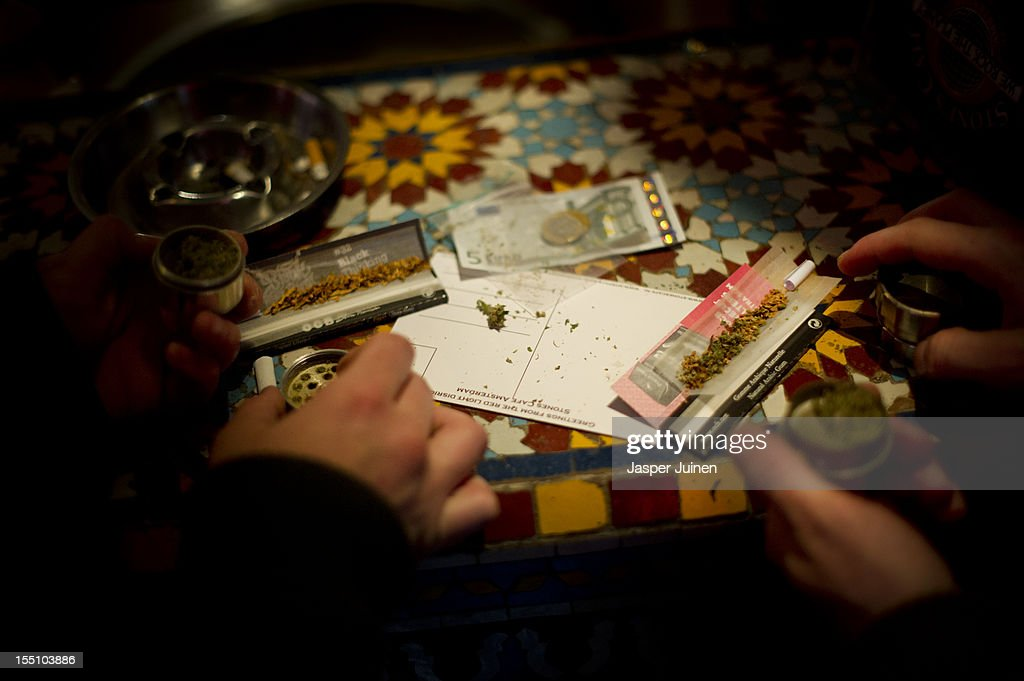 Cannabis joints are being rolled, costing 10 Euros per gram, in a coffee shop on November 1, 2012 in the center of Amsterdam, Netherlands. Coffee shops in the Dutch captial will remain open to tourists after its mayor, Eberhard van der Laan, decided that tourists will not be banned from the 220 coffee shops in Amsterdam where marijuana and hashish are openly sold and consumed. The decision came after the new government of the Netherlands stated that it would be up to local authorities to decide whether or not to impose a ban on cannabis.