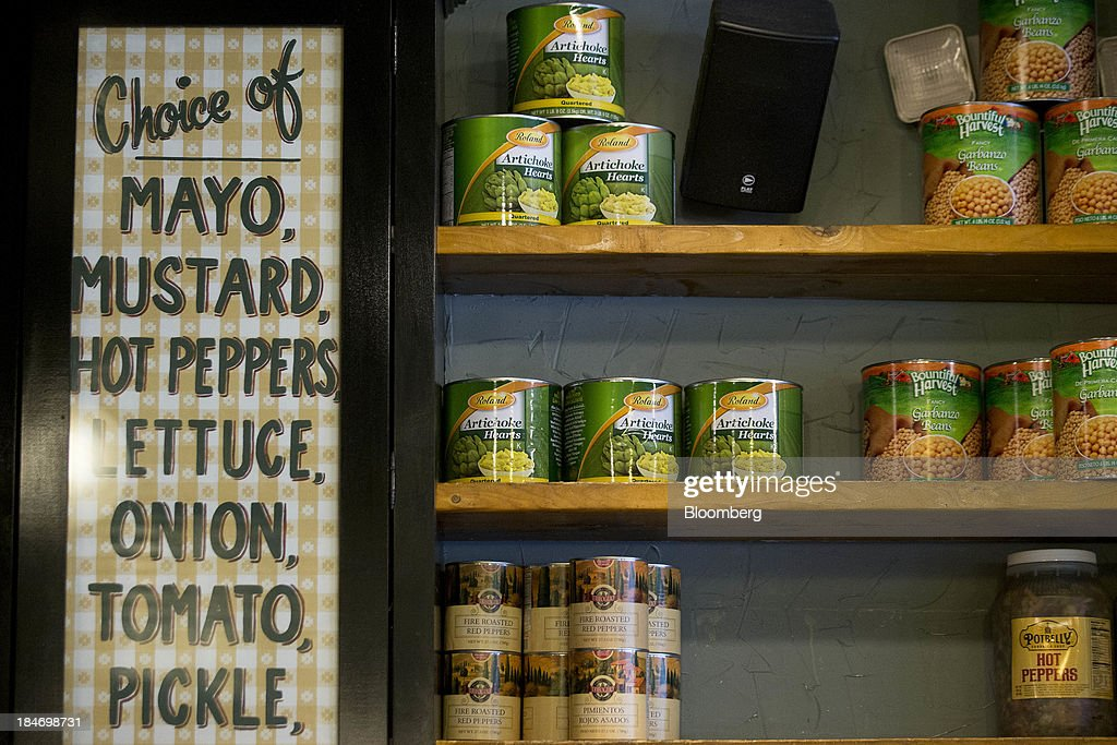 Canned condiments sit on shelves at a Potbelly Sandwich Shop in Washington, D.C., U.S., on Tuesday, Oct. 15, 2013. Potbelly Corp., the Chicago-based purveyor of made-to-order toasted sandwiches, held its initial public offering (IPO) on Oct. 4. Photographer: Andrew Harrer/Bloomberg via Getty Images