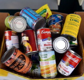 Canned food donated at Cost Plus World Market's Share the Joy event with celebrity chef Curtis Stone at Cost Plus World Market on December 8 2012 in...