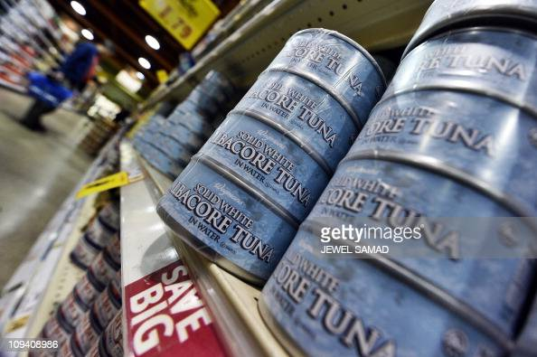 Canned tuna are pictured as a man shops at Wegmans Foods store in Fairfax Virginia on February 24 2011 Wegmans the supermarket chain which has...