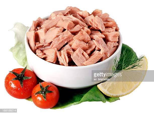 Canned tuna chunks in a bowl garnished with tomatoes
