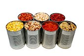 Selective focus of canned corn, beans, tomatoes and mushrooms on a white background