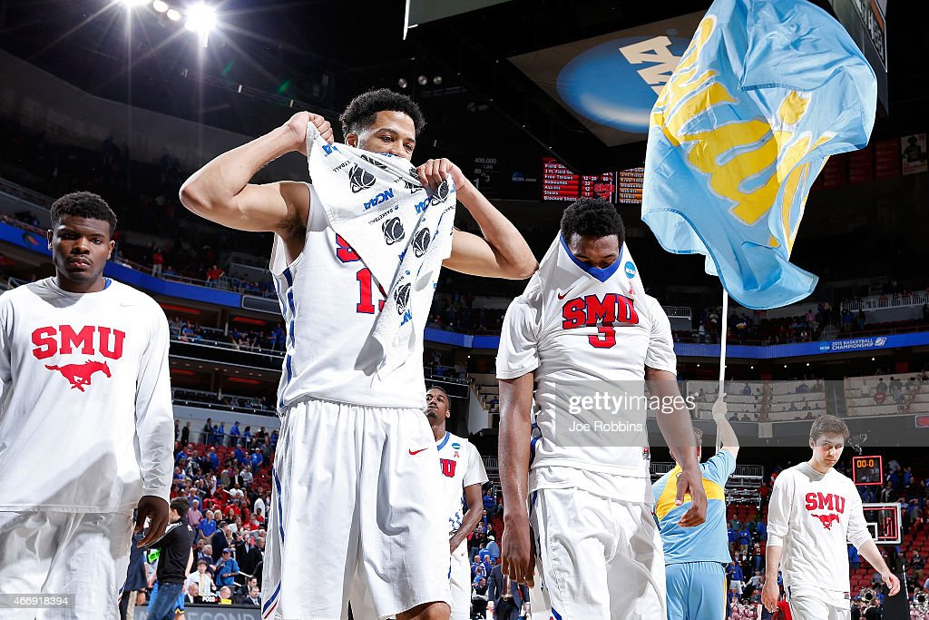 Cannen Cunningham #15 and Sterling Brown #3 of the Southern Methodist Mustangs walk off the court after losing against the UCLA Bruins during the second round of the 2015 NCAA Men's Basketball Tournamenat at the KFC YUM! Center on March 19, 2015 in Louisville, Kentucky.
