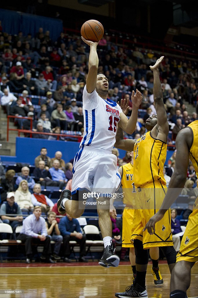 Cannen Cunningham #15 of the SMU Mustangs drives to the basket against the Wyoming Cowboys on January 2, 2013 at the Moody Coliseum in Dallas, Texas.