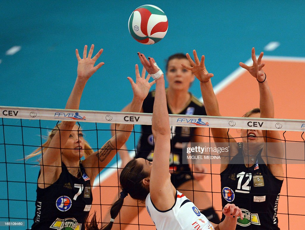 Cannes' Ana Antonijevic (L) and Victoria Ravva (R) try to block Calais' Tamara Matos Hoffman (C) during the Women French Championship volleyball final match Cannes vs Calais on March 30, 2013 at the Coubertin Stadium in Paris.
