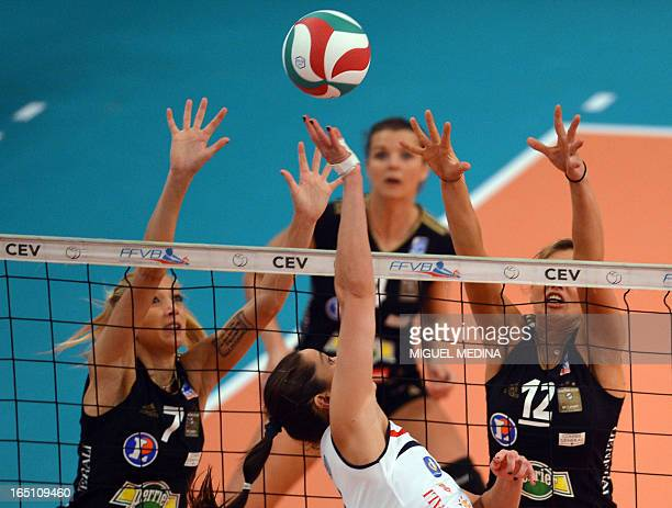 Cannes' Ana Antonijevic and Victoria Ravva try to block Calais' Tamara Matos Hoffman during the Women French Championship volleyball final match...