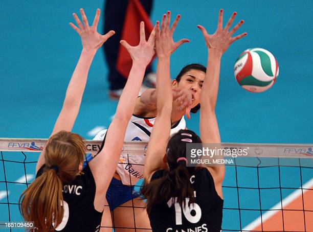 Cannes' Brankica Mihajlovic and Milena Rasic try to block Calais' Maria Jose Perez Gonzalez during their Women French Championship volleyball final...
