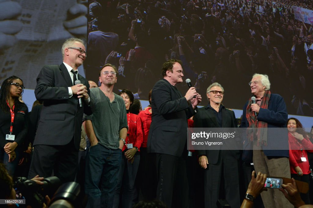Cannes Film Festival artistic director Thierry Fremaux, actor Tim Roth, director Quentin Tarantino, actor Harvey Keitel and director Bertrand Tavernier on stage during the closing ceremony of the 'Lumiere 2013, Grand Lyon Film Festival' on October 20, 2013 in Lyon, France.