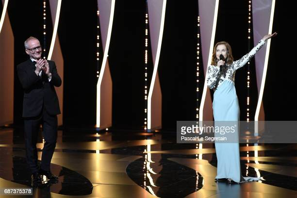 Cannes Film Festival artistic director Thierry Fremaux and Isabelle Huppert are seen on stage at the 70th Anniversary Ceremony during the 70th annual...