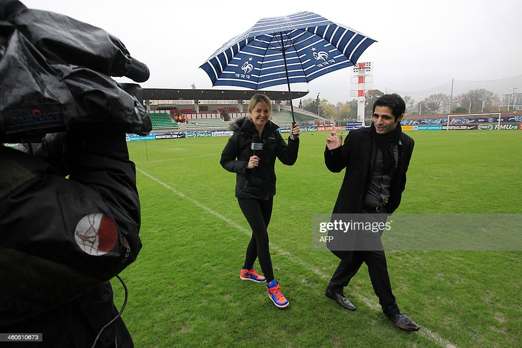 Cannes' football club president Ziad Fakhri leaves the pitch after an interview at the Coubertin stadium in Cannes, southeastern France, on January 4, 2014 as a French Cup football match between Cannes and Saint-Etienne has been postponed until tomorrow because of the weather condition.