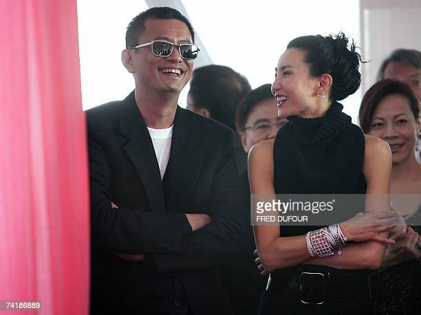Chinese director Wong Kar Wai and member of the Jury Chinese actress Maggie Cheung laugh 18 May 2007 as they attend the 'Anniversary Exhibition...