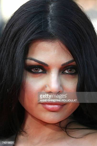 Lebanese singer Haifa Wehbe poses 24 May 2007 upon arriving at the Festival Palace in Cannes southern France for the premiere of US director Steven...