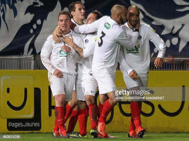 Cannes' French midfielder Mickael Darnet celebrates with teammates after scoring a goal during the French Cup football match between Cannes and...