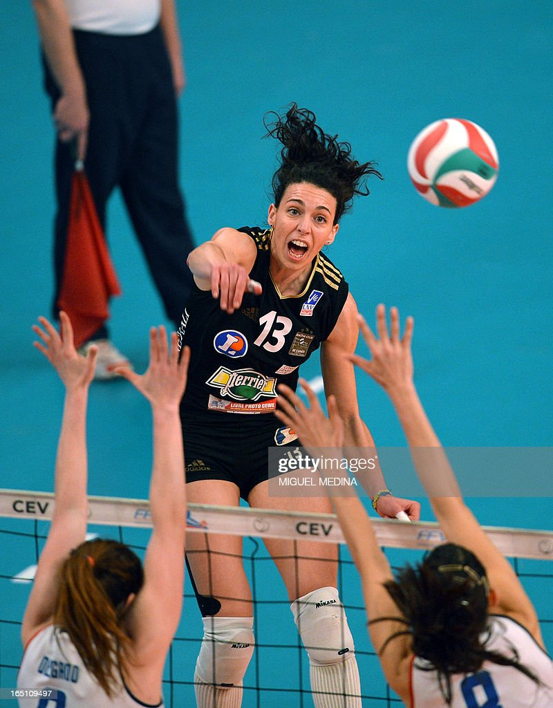 Cannes' Nadia Centoni jumps to spike during the Women French Championship volleyball final match Cannes vs Calais on March 30, 2013 at the Coubertin Stadium in Paris.