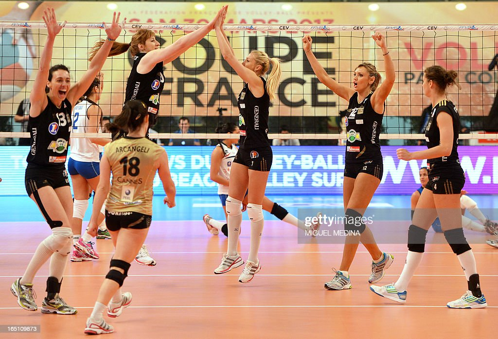 Cannes' players celebrate after winning against Calais during the French Women's Volleyball Championship final match Cannes vs Calais on March 30, 2013 at the Coubertin Stadium in Paris. AFP PHOTO / MIGUEL MEDINA
