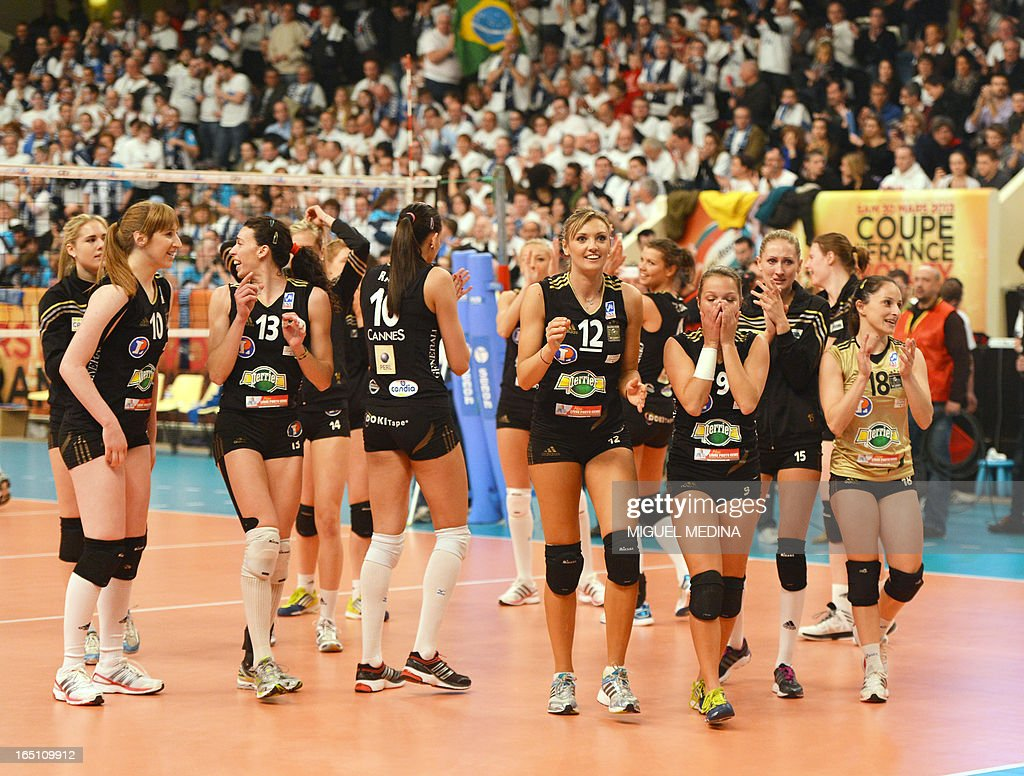 Cannes' players celebrate after winning against Calais during the French Women's Volleyball Championship final match Cannes vs Calais on March 30, 2013 at the Coubertin Stadium in Paris.