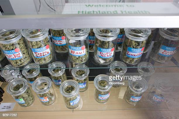 Cannisters of medical marijuana are displayed in a cabinet inside Highland Health medical dispensary and wellness center in Denver Colorado US on...