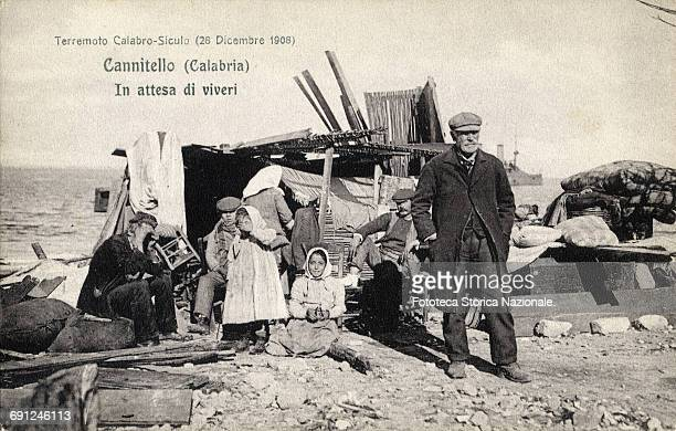 Cannitello a hamlet of Villa San Giovanni family awaiting provisions with the few assets that could save by the cataclysm in a makeshift shelter The...