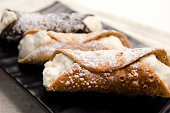 Cannoli Italian sweet dessert. Selective focus.