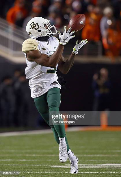Cannon of the Baylor Bears pulls in a touchdown pass against the Oklahoma State Cowboys in the first quarter at Boone Pickens Stadium on November 21...