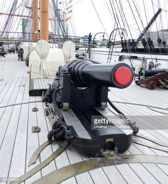 Cannon on the deck of HMS Warrior the Royal Navy's first ironclad oceangoing armoured battleship and was launched in 1860 She became a depot ship in...