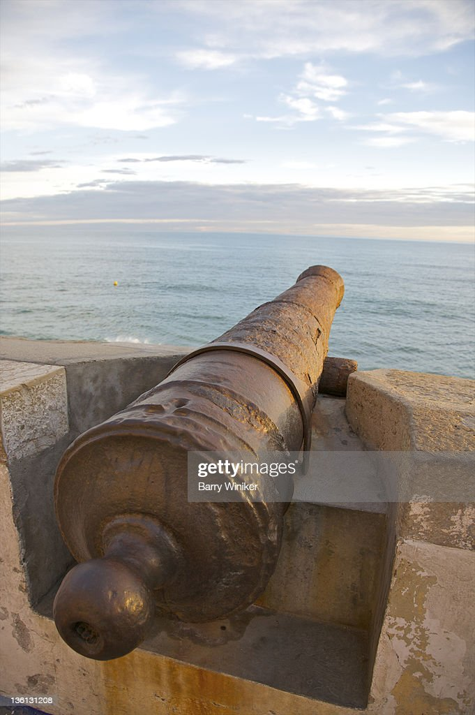 Cannon pointed out to sea in late afternoon.