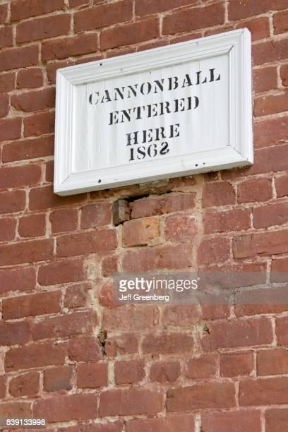 A cannonball struck brick wall 1862 sign at John Wesley Methodist Church