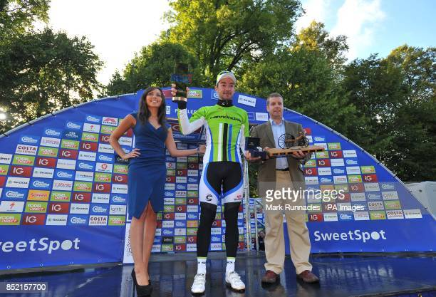 Cannondale's Elia Viviani celebrates on the winners podium after winning the first stage of the 2013 Tour of Britain between Peebles and Drumlanrig...