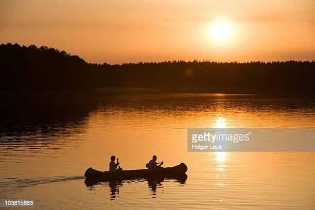 Canoe at sunset on Lake Zotzensee, Mecklenburgian Lake District.