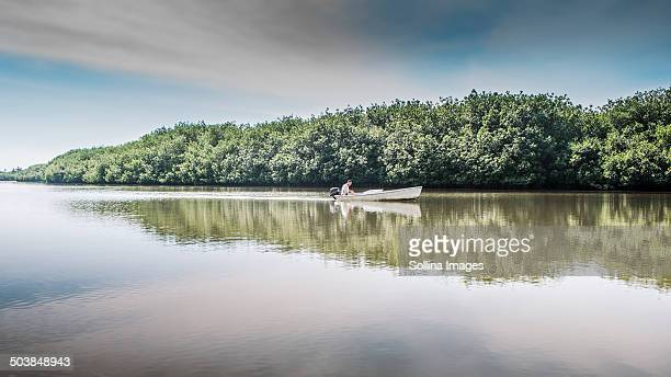 Canoe floating in still rural lake