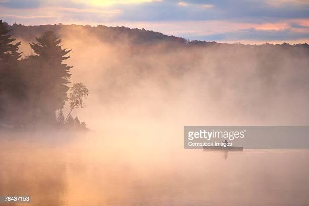 Canoe on a foggy lake