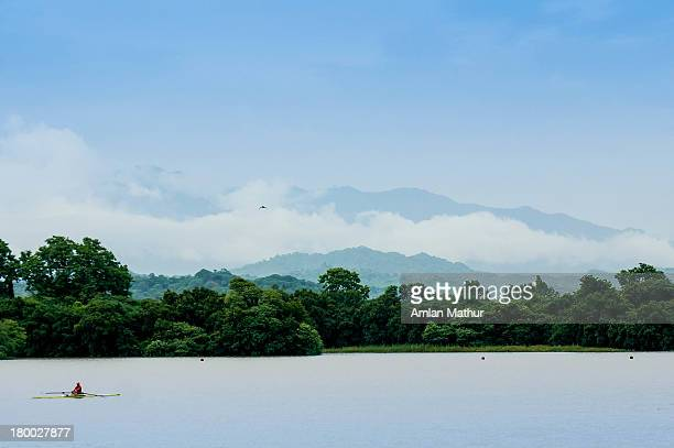 Canoe on a lake against cloud covered hills