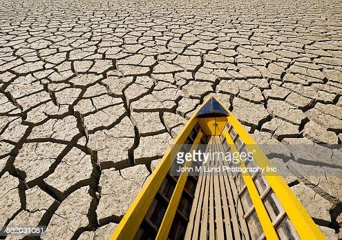 Canoe on cracked dry desert land